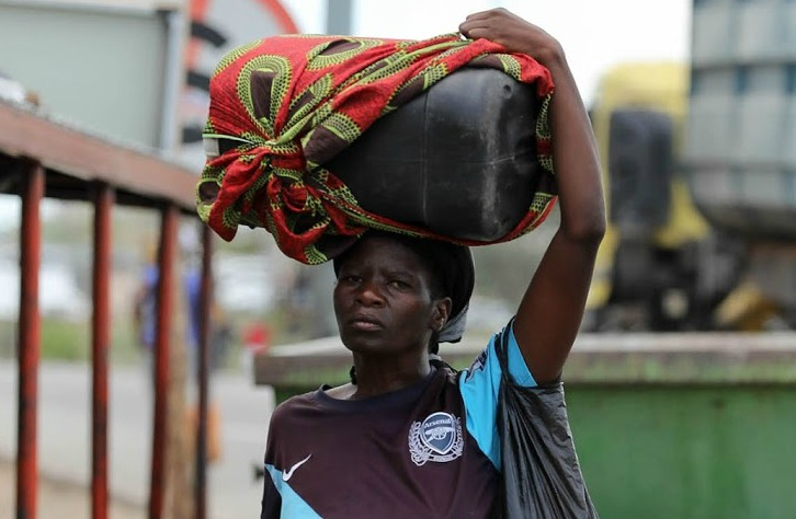 Hamila Simba carries petrol to Zimbabwe.