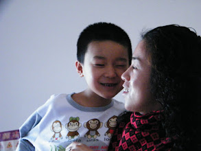 Photo: baby son, warrenzh, 朱楚甲 gratified by his new clothes his mom prepared for lunar Spring Festival.