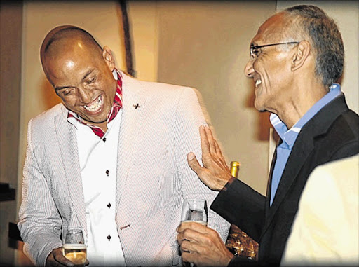 Kenneth Diedricks and lawyer Vas Soni at Diedricks's 40th birthday party at the Saxon in 2012. Soni would be appointed South Africa's anti-corruption boss the next year