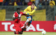 Jeremy Brockie of Mamelodi Sundowns fouled by Aboubacar Camara of Horoya during the 2018 CAF Champions League match between Mamelodi Sundowns and Horoya at the Lucas Moripe Stadium, Atteridgeville on 28 August 2018.