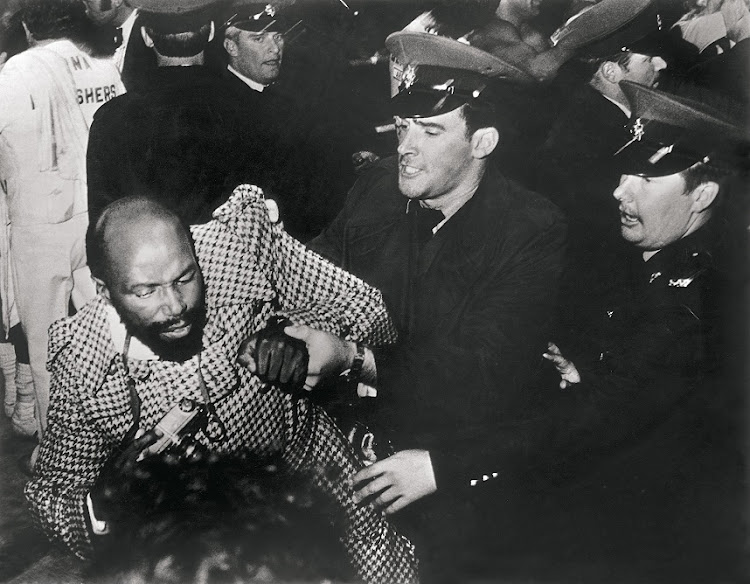 Alf Kumalo is arrest by the police in 1976.