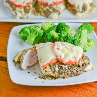 Baked Pesto Chicken with Tomato and Mozzarella Cheese.