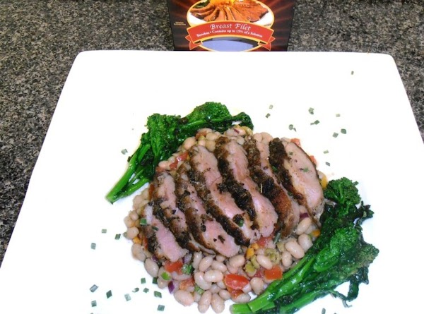 place the bean salad on a plate and top with duck.  pour duck...