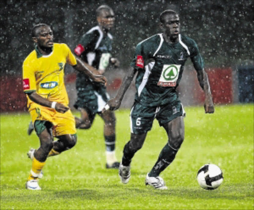 AWOL: AmaZulu's Mohammed Issah-Awal, right, has been ordered to pay Usuthu R1.7m Photo Anesh Debiky/Gallo Images