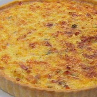 Classic Quiche Lorraine with green salad and vinaigrette.