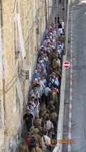 Photo: two sides to the city, tourists and Isreali Defense Forces.... going in different directions....