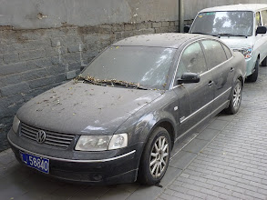 Photo: Beijing - clean parked VW on stinky Gulou West street
