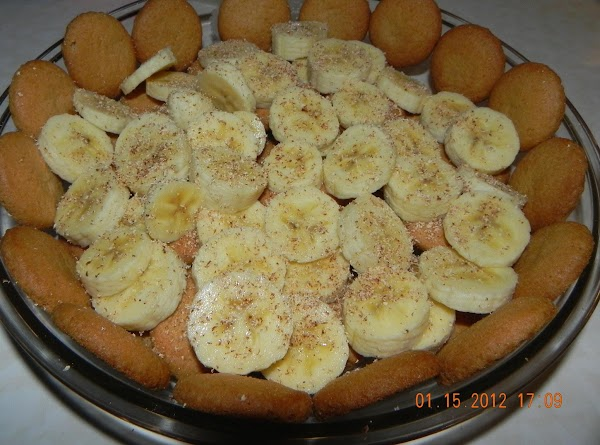 Slice 2 bananas and arrange evenly on top of wafers. Sprinkle with 1/4 teaspoon...