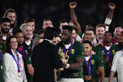 Springboks captain Siya Kolisi is presented the Webb Ellis Cup by Japan's Crown Prince Akishino.