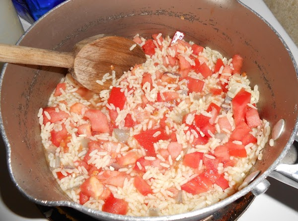 Stir in the rice, broth and tomatoes. Bring to a boil. Reduce heat to...