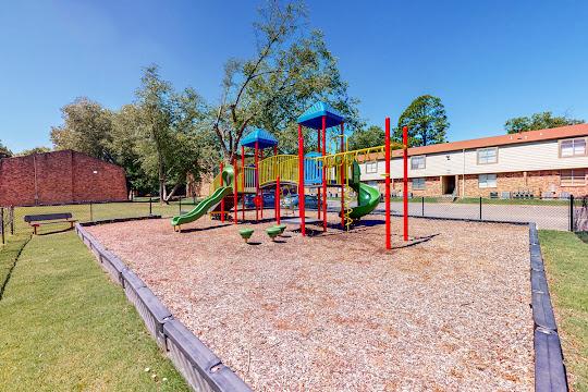 Community playground with slides and equipment