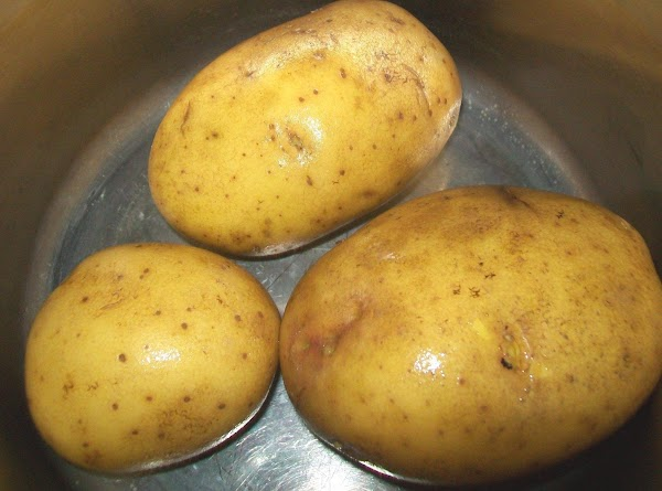 Wash the potatoes { leave whole } and unpeeled.