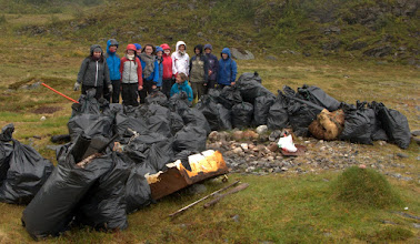 Photo: A school class collecting marine litter. 60 sacks this time, mostly plastic.