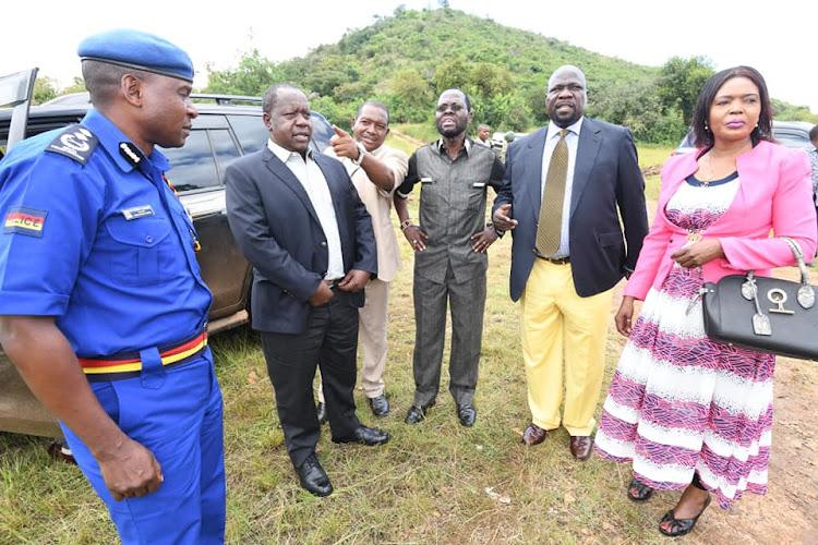 Interior CS Fred Matiang'i with Nyanza regional commissioner James Kianda, Muhoroni MP Onyango Koyoo and Nyanza police Commander Vincent Makhoha when they visited the Rapid Deployment Unit in Songho, Muhoroni subcounty, Kisumu.