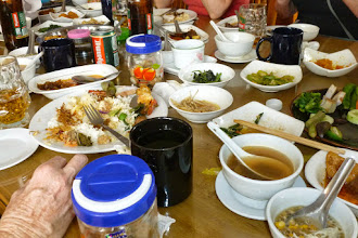 Photo: Our group stopped at a small outdoor restaurant for lunch.  We all choose a main dish and the rest of the food was brought along to our table.  I had bottled water and the bill was $3.