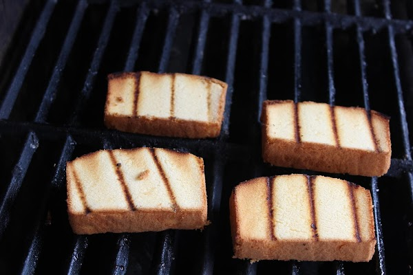 Place cake slices on grill and toast and get grill marks on them. Flipping...
