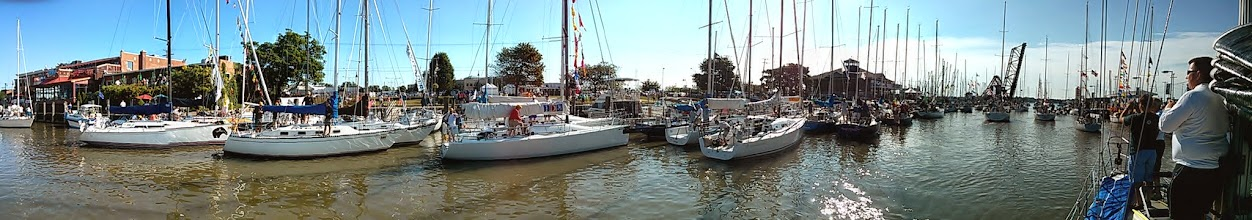 Photo: panorama of boats head out for the start of the race