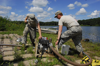 Photo: Wisconsin National Guard Soldiers from the 257 Brigade Support Battalion performed their 2-week annual training at Camp Ripley, Minn. this month. Water Treatment Specialists of Alpha Company spent a few days at Lake Ferrell testing the water, their skills and their equipment. Spc. Daniel Clark starts the water pump.  Photo by Sgt. 1st Class Daniel Ewer http://www.minnesotanationalguard.org/press_room/e-zine/articles/index.php?item=3429