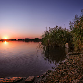 Silence by Dmitriy Yanushevichus - Landscapes Sunsets & Sunrises ( water, reflection, sunset, peace, silence, lake, rest, boat, reeds, river )