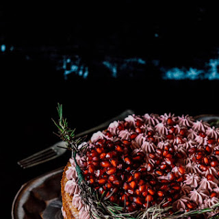 White chocolate peach cake with rosemary pomegranate SwissMeringue Frosting