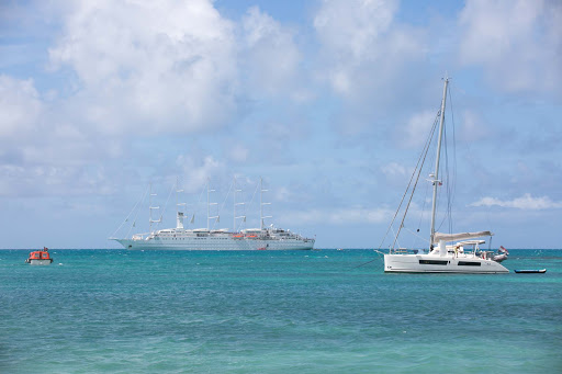 Wind-Surf-in-Barbuda.jpg - Wind Surf and smaller ships in an isolated cove in Barbuda in the Caribbean.