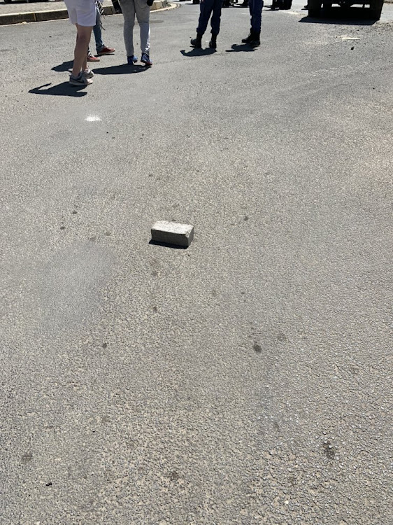 A brick allegedly thrown at bikers, farmers and community members in Senekal by EFF supporters.