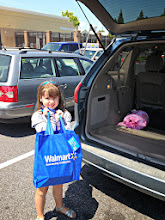 Photo: My daughter wanted to help load the car so she put the reusable bag in the trunk. After that, we were off to our house to make some great food with the help of the groceries we had bought!