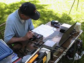Photo: Earl Wilson K6GPB answers a call with the Elecraft KX1