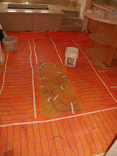 Photo: Laying down the heating elements for the Bathroom Floor