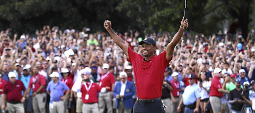 Cool cat: Tiger Woods celebrates winning the Tour Championship on Sunday, his first tournament victory in five years. Picture: GETTY IMAGES
