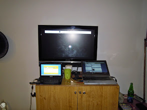 Photo: Busy day setting up slideshow for wireless networking presentation and grant application.