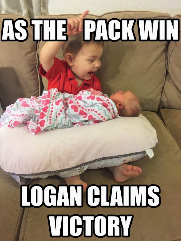 Logan doing double duty...watching his baby sister and getting jazzed about the Packers win over the Cowboys!!