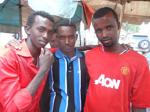Photo: Guys at the market - they helped me find a music store where I bought a pirated CD of Somali music, which didn't work...