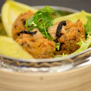 Foot To Tail Croquettes with Herb Salad and Cherry Mustard.