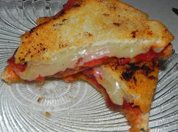 Once your tomatoes are done prepare a frying pan to grill your sandwiches. Layer...