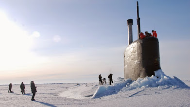 Photo: Mar. 19, 2011: Crew members look out from the USS Connecticut, a Sea Wolf-class nuclear submarine, after it surfaced through ice in the Arctic Ocean. The U.S. and other countries are building up their military presence in the Arctic to help exploit its riches - and protect shifting borders.