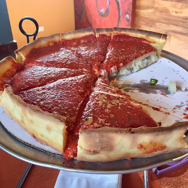 Stuffed deep dish supreme pizza