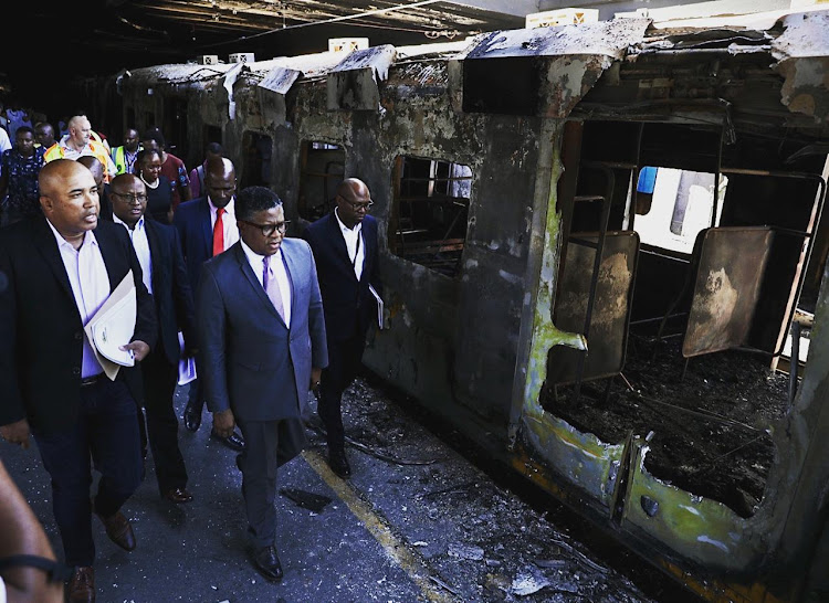 Transport minister Fikile Mbalula on Thursday visited Cape Town station following the burning of 18 train carriages in the early hours of the morning.