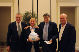 Photo: Members of the 1957 UNC National Championship Basketball Team --  Pete Brennen, Johnny Surles - (winner of the signed 1957 Championship Basketball) , Lennie Rosenbluth and Joe Quigg