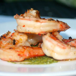 Lemon and Garlic Marinated Grilled Shrimp with an Arugula and Walnut Pesto.
