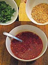 Photo: adding cilantro and chopped peanuts to sauce