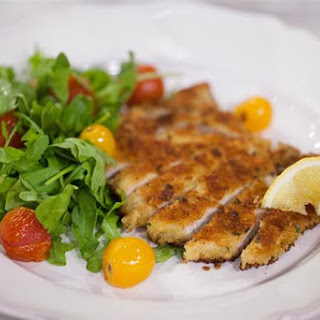 Parm-Crusted Pork Chops with Lemony Arugula and Tomato Salad