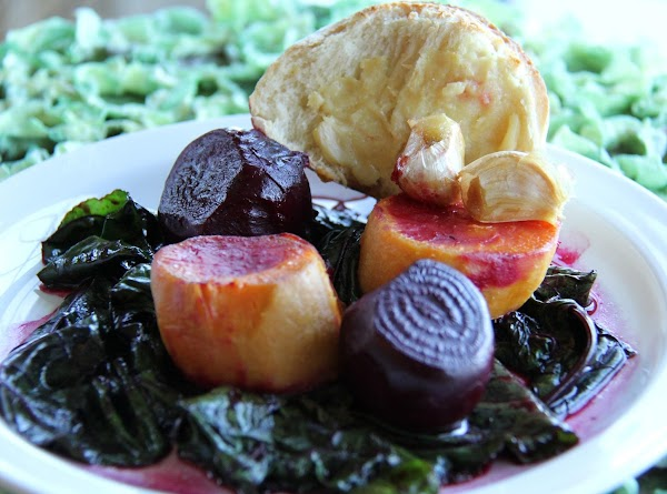 Serve the vegetables on a warm bed of greens with a hunk of garlic...