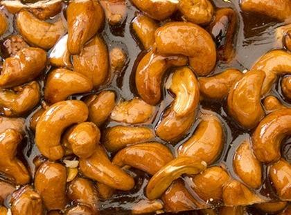 Add the nuts, stirring constantly while boiling mixture 10-12 minutes or until the mixture...