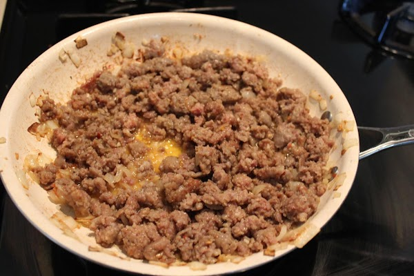 STUFFING: Heat oil in large skillet and saute onions and garlic until softened. Add the...