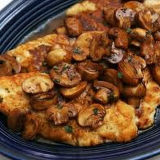 Sautéed Chicken Breasts In Garlic Olive Oil with Mixed Mushrooms.