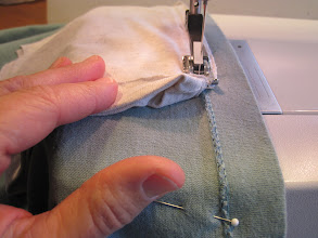 Photo: When you get to the open end of the drawstring bag, move it out of the way as you sew through so you don't close it up.