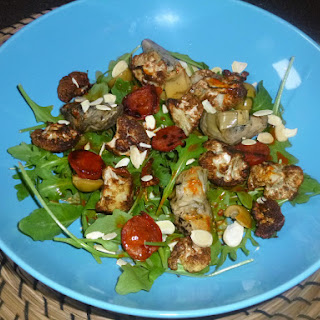 Middle Eastern Roasted Cauliflower, Chorizo and Artichoke Salad with a Harissa, Lemon and Honey Dressing