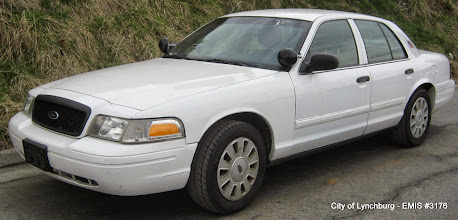 Photo: Lot 18 - (3176-1/1) - 2011 Ford Crown Victoria - 104,260 miles
