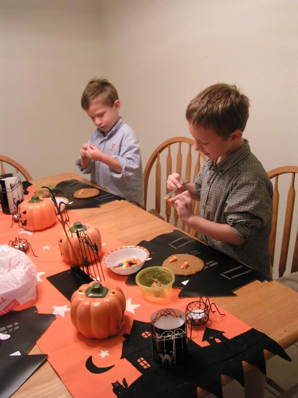 Once completely cooled; decorate, using icing or peanut butter to affix assorted candies, raisins...